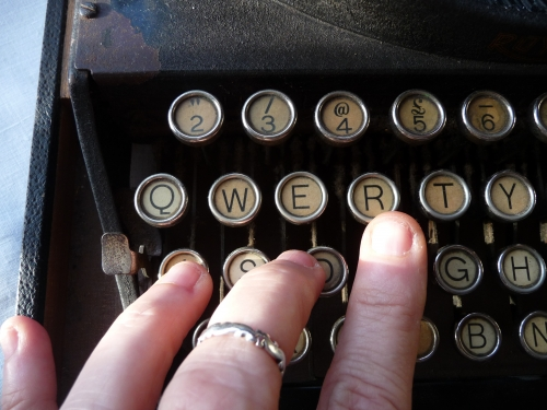 tapping the keys of Warnie's typewriter